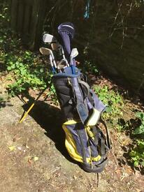 Young persons left handed golf clubs