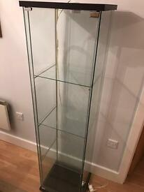 Glass display cupboard with illumination lights inside