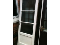 Exterior wooden door with 3 frosted single pane panels