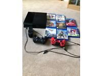 PS4 console in v good condition complete with accessories including two controllers and eight games