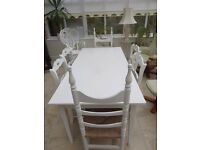 White dining room table with 8 chairs