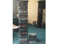 62 DVDs plus stand.