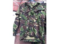 Two army combat light weight jackets.