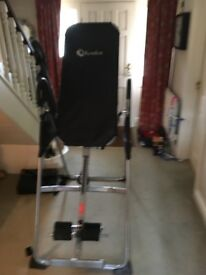 Inversion table. Great for core strength.