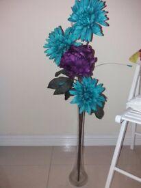 Turquoise flowers in vase