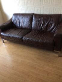 Brown leather 3 seater and 2 seater sofas good condition slightly dented on 1 arm