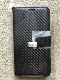 £1. NEXUS 6 case and screen protector plus wipe.