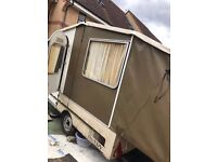 Caravan that folds into trailer.