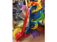 Never used - fisher price loops and wheels toy