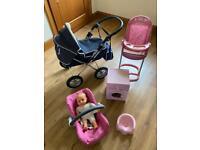 Dolls Silvercross pram, washing machine, dolls highchair, dolls car seat, and potty bundle