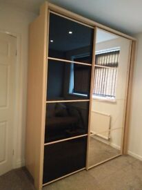 Large wardrobe with sliding doors and full length mirror