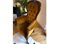 Victorian style armchair in burnt orange velvet