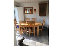 Large extending wooden kitchen table & 6 chairs