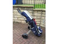 Golf clubs, bag and collapsable trolley