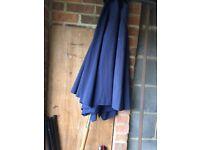 Navy blue fabric garden parasol with metal base