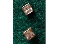 Four pairs of sterling silver studs