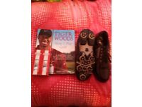 Dunlop golf shoes, Srixon balls, and book by Tiger woods