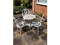 Gardens table and three chairs in heavy alluminium