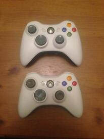 Two Xbox 360 Pads