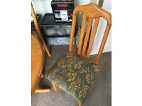 Wood round table and upholstered 4 chairs