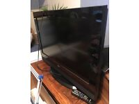 Large television and glass stand