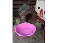 Large wooden dog kennel and large plastic dog bed. Kennel needs a coat of paint .