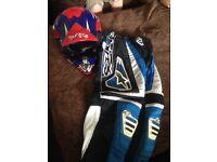 Motocross trousers and helmet