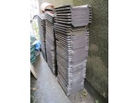 Approximately 120 used Marley roof tiles for shed/lean to