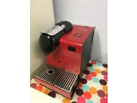 Red Delonghi Nespresso machine (milk container missing) very good condition