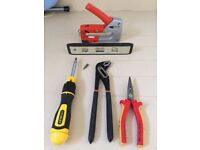 Various Hand Tools: level, screwdriver, staple gun, plyers, wrench