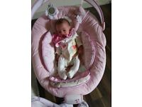 Pink baby bouncy seat