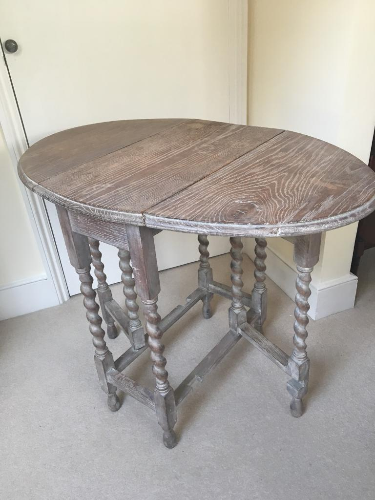 Vintage looking gate legged fold down side table. Bleached oak table with limed finish