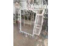 Ornate garden mirror