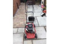 Sovereign petrol lawnmower, only 14 months old. Good working order.