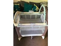 Space saver travel cot