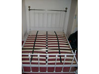 White Double Bedstead (Brass?) With Wooden Slats. No Mattress