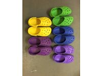 5 pairs of Crocs in assorted colours - size M7/W9
