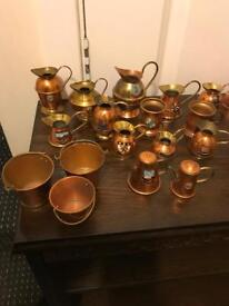 A collection of miniature copper and brass ornaments