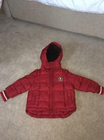 Waterproof padded coat with fleece lined hood. Age 12-18 months.