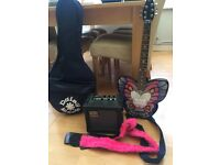 Daisy Rock guitar + accessories