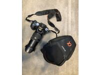 SONY ALPHA DSLR-A100 CAMERA WITH 18-200 MM F 3.5-6.3 LENSE, SOFT CASE BATTERY AND CHARGER