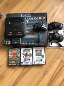 Sega Megadrive 2 (original) , with Mega Everdrive Cart containing hundreds of games, 3 controllers