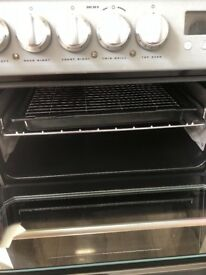 Hotpoint 60cm wide . Ceramic double oven in silver .in excellent condition