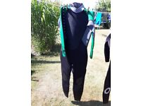 Odyssey surf wetsuits size medium s . Used once only cost over 70.00 like new 25.00 each