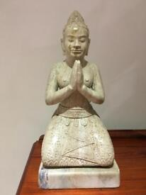 Apsara hand carved stone statue
