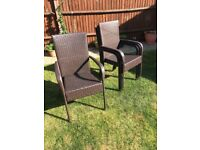 Four All-Weather Rattan Dining Chairs