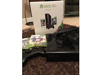 Xbox 360 with game, headset and controller.