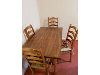 table and 4 chairs in dark brown wood