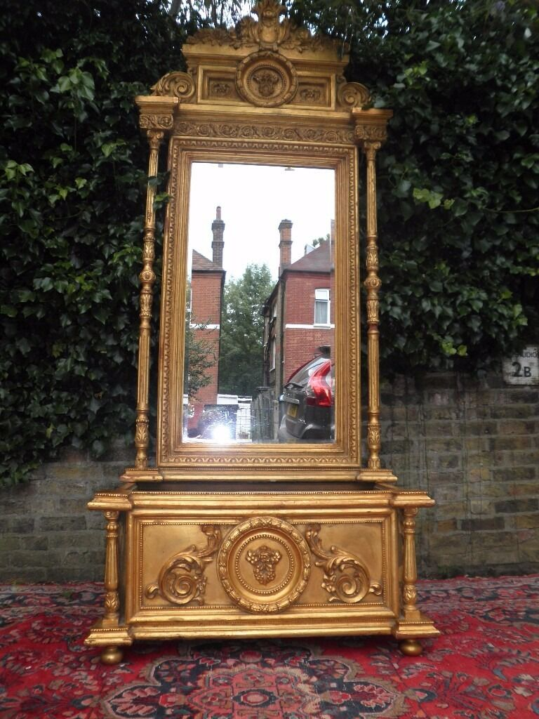 French Baroque Louis XIV Gilt Wood Large Mirror with storage base for bootsshoes etcin Kilburn, LondonGumtree - Large Beautiful Spectacular Antique Baroque Louis XIV Hand Carved Gilt Wood Large Mirror with storage base for boots & shoes umbrellas etc.. etc VERY GOOD CONDITION PLEASE SEE MY OTHER FRENCH EMPIRE LOUIS XV1 FURNITURE THANK YOU