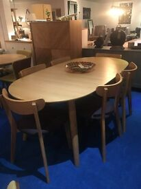 Enza 6-10 person extending dining table and 6 padded clio chairs rrp £1050